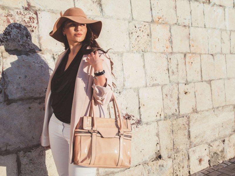 model posing with a large handbag