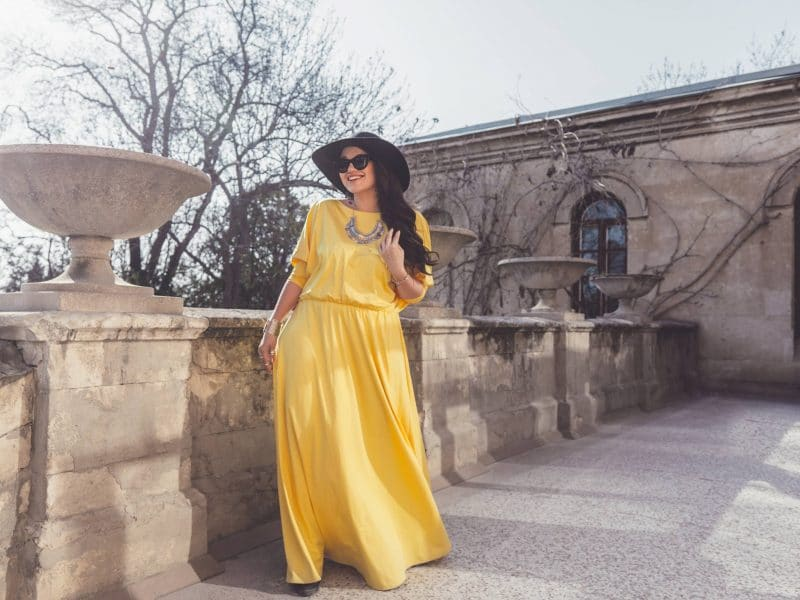 plus size model in a yellow dress