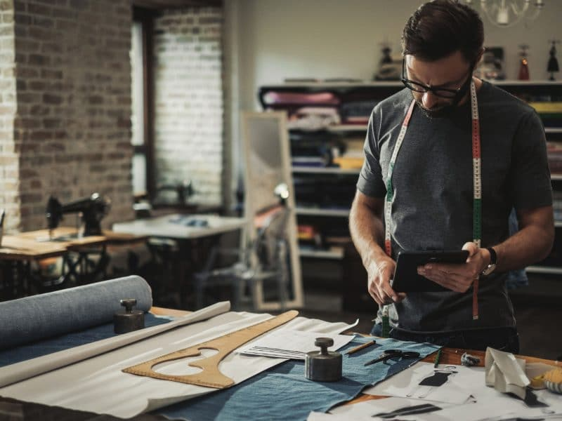 Fashion designer working in his studio.